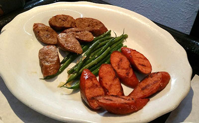 Fresh smoked andouille sausage with French beans and garlic